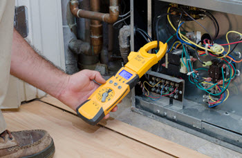 image of an HVAC contractor repairing an air conditioner
